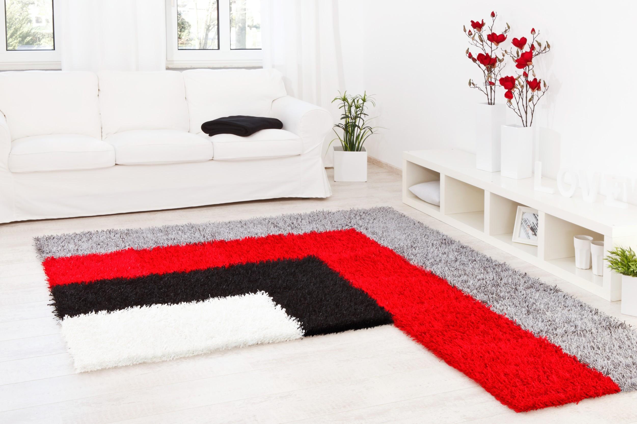 Teppich Al Mano Beispiel: L-Form in vier Farben (weiß, schwarz, rot, grau)